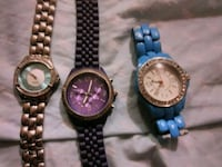 three round silver analog watches Calgary, T2A 5L2