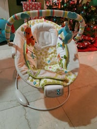 baby's white and green bouncer Toronto, M9M 2X3