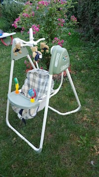 white and gray Graco swing chair