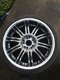 chrome multi-spoke auto wheel with tire