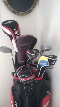 red and black golf bag with golf clubs Winnipeg, R2W 0G2