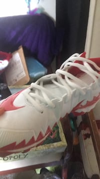 pair of white-and-red Nike basketball shoes