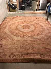 100% wool tea stain carpet.  Very heavy 9'x12' great condition