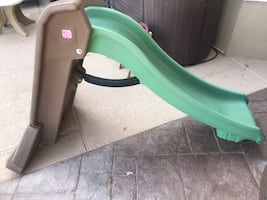 Green and brown plastic slide