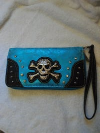 Skull wallet with rhinestones and studs