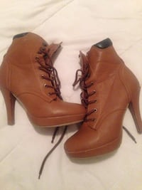 pair of brown leather heeled booties Central Okanagan, V4T
