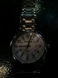 round silver-colored analog watch with link bracelet Vancouver, V6B 1R3