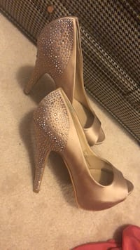 pair of brown leather peep toe platform stilettos Brampton, L6P 1S7