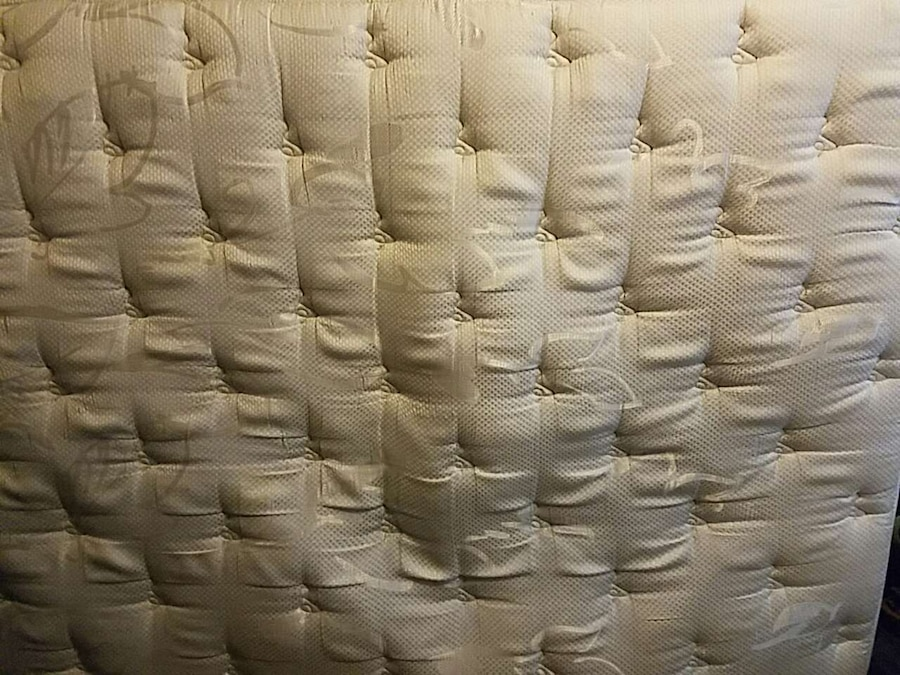 white tufted mattress