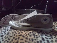 unpaired gray and white Converse All Star low-top sneakers