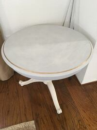 Cute round wooden side table