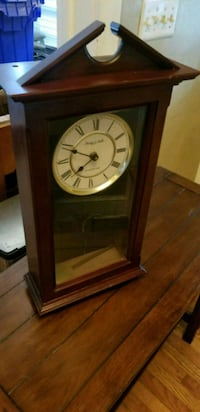 brown wooden framed pendulum clock 39 km