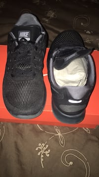 pair of black Nike running shoes Arlington, 22204