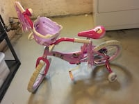 pink and red bike with training wheels