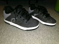 pair of black-and-white Adidas sneakers 446 mi