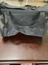 Black pet carrier with lined bottom
