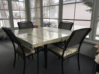 rectangular glass top table with four chairs dining set Maple Grove, J6N 3R7