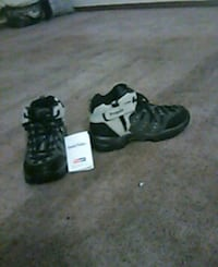 pair of black-and-white Nike basketball shoes Evansville