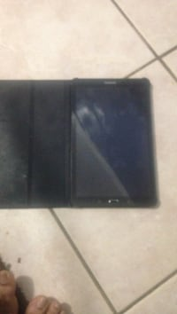 black Samsung Galaxy Tab series tablet and black flip case Brampton, L6V 3X3
