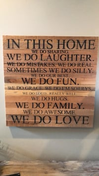brown wooden quote wall decor