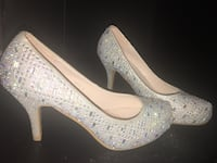 pair of white peep-toe platform stilettos Toronto, M6H 3Z9