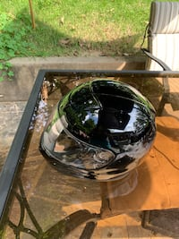 black and gray full-face helmet 22 mi
