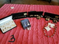 assorted pairs of earrings; assorted gold necklace