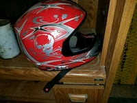 red and gray full-faced motorcycle helmet 1965 km