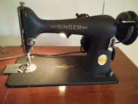 black Singer treadle sewing machine null