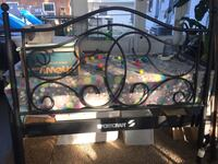 Full size rod iron bed frame. I do not have the hardware for this but it wouldn't take no more then a few nuts and bolts. In good shape.  Edgewater, 32132