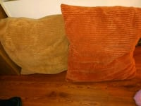 two brown and orange throw pillows