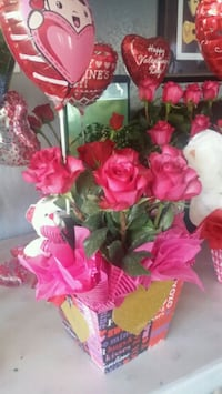 red petaled roses with pink balloon