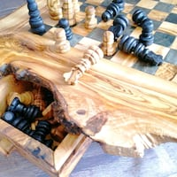 Rustic handcrafted chessboard in olive wood  Montréal, H2G 2V2