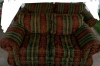 green and red floral fabric loveseat.. Odessa