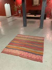 Brown and red area rug from Mexico Toronto, M5V 1H6