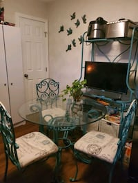 Wrought iron 4 piece table set with bakers rack