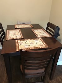 Brown solid dining room table  Jacksonville, 32208
