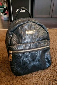 BCBG faux alligator black backpack