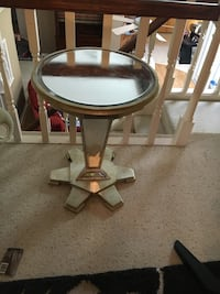Round gold framed glass top side table