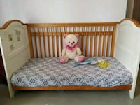 baby's brown wooden crib