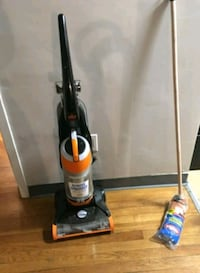 black and red upright vacuum cleaner Boston, 02118