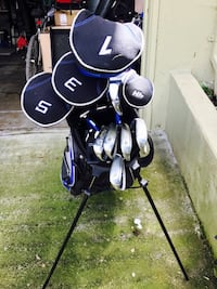 White,blue,and black golf bag and stainless steel golf club set