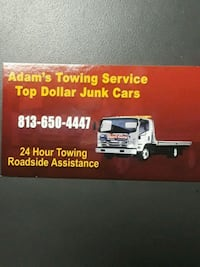 Adam's Towing Service business card