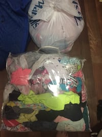 assorted clothes in plastic bag Waterbury, 06710