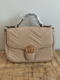 Light Beige GG Bag...Ordered Large Size and came Small...My loss your gain!  Ottawa, K2S