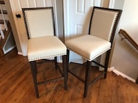 two white padded brown wooden chairs Leesburg, 20175