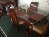 Wooden table with chairs