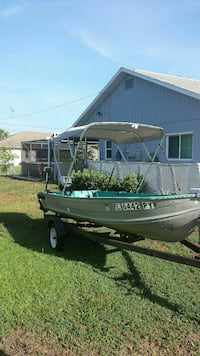 grey and green FL 6442 PY personal boat