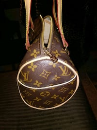 brown and black Louis Vuitton leather bag Westminster, 80021