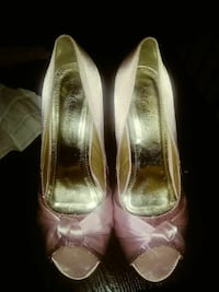pair of gold-and-pink peep-toe pumps